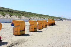 Roofed wicker beach chairs. Egmond aan Zee, North Sea, the Netherlands. Royalty Free Stock Images