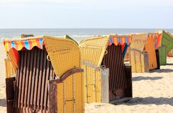 Roofed wicker beach chairs. Egmond aan Zee, North Sea, the Netherlands. Stock Image