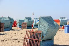 Roofed wicker beach chairs. Egmond aan Zee, North Sea, the Netherlands. Stock Photos