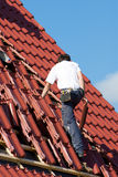 Roofer. At work on a building Stock Photography