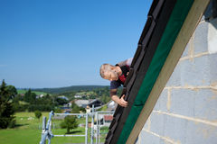 Roofer applying slates Royalty Free Stock Images