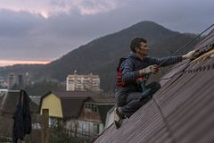 Roofer. Assembles sheet metal on the roof. s on the roof Royalty Free Stock Photos