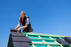 Roofer Assembling Edged Tiles To The Roof Royalty Free Stock Images