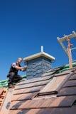 Roofer assembling tiles on a chimney Stock Photo