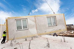 Roofer builder workers with crane installing structural Insulated Panels SIP. Building new frame energy-efficient house. Stock Image