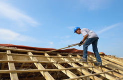Roofer. A carpenter roofer who renovated the roof Stock Photography
