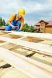 Roofer carpenter works on roof Royalty Free Stock Image