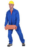 Roofer carrying tiles roof. Stock Photos