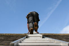 Roofer, climbing a ladder Stock Photo