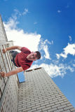 Roofer descends stairs from roof Royalty Free Stock Photos