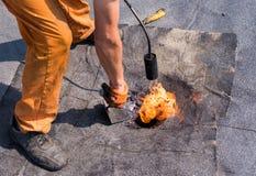 Roofer doing repair roof drain. Stock Photo