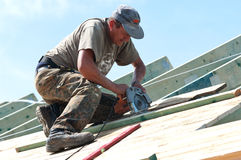 Roofer with Electric Saw royalty free stock images