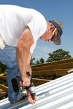 Roofer Fastening Metal Roof Stock Photos