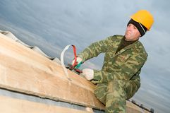 Roofer with hand snips Royalty Free Stock Images