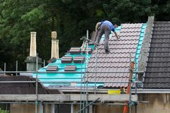 Roofer Laying New Tiles royalty free stock photo