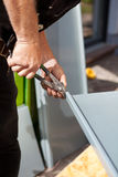 Roofer making cuts on a metal sheet Royalty Free Stock Photo