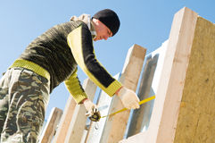 Roofer with measure tape Royalty Free Stock Images