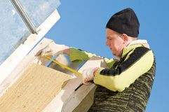 Roofer with measure tape Stock Image