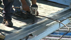 Roofer with nailgun Royalty Free Stock Photography