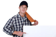 Roofer pointing Stock Photo