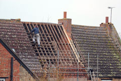 Roofer repairing roof. Stock Image