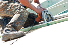 Roofer with rotary drill. Legs and arms of worker on rooftop using rotary drill Stock Photos