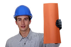 Roofer showing tile Stock Image