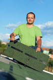Roofer on top of building Stock Images