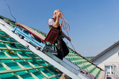 Roofer using the elevator Stock Image