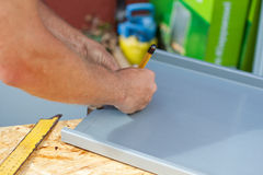 Roofer using a pencil to make markings Stock Photography