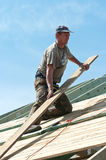 Roofer at work on building Stock Images