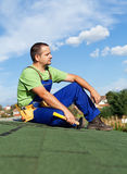 Roofer worker resting on top of building Stock Images