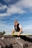Roofer working with an angle ruler on a rooftop Stock Photography