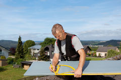 Roofer working with an angle ruler stock image