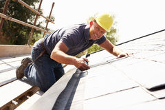 Roofer Working On Exterior Royalty Free Stock Photography
