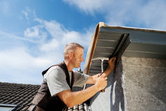 Roofer working on a new dormer Royalty Free Stock Photo