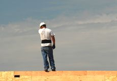 Roofer working on a roof Stock Photography