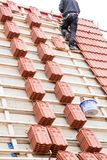 Roofer working on roof structure of building on construction sit stock image