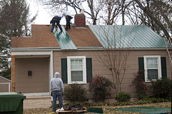 Roofer Working On A Roof Stock Photo