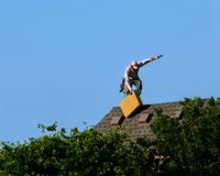 Roofer Working Slips Royalty Free Stock Photography