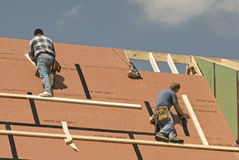 Roofers Constructing New Home Revised Stock Image