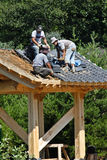 Roofers in Korean Bell Meadowlark Gardens. Roofing artists place ceramic tiles on roof of structure in 1st Korean Bell Garden in the Western Hemisphere ( Stock Photos