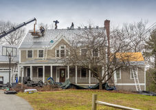 Roofers laying down a new roof Royalty Free Stock Photography