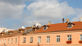Roofers on the roof. Royalty Free Stock Image