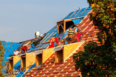 Roofers on the roof. Royalty Free Stock Photography