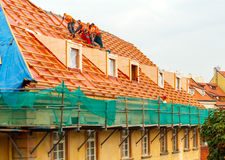 Roofers on the roof. Royalty Free Stock Photo