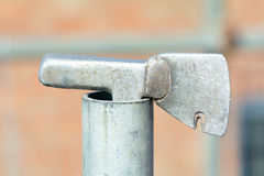 Roofers tiling hammer in end of scaffolding pole Stock Photography