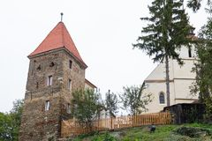 The Roofers Tower standing near of the Church of the Deal St. Nicholas in the castle in Old City.  Sighisoara city in Romania Royalty Free Stock Photo
