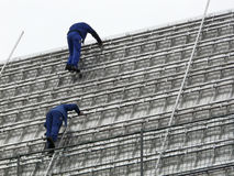 Roofers at work Stock Images