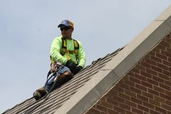 Roofers work on Campus 2019 II